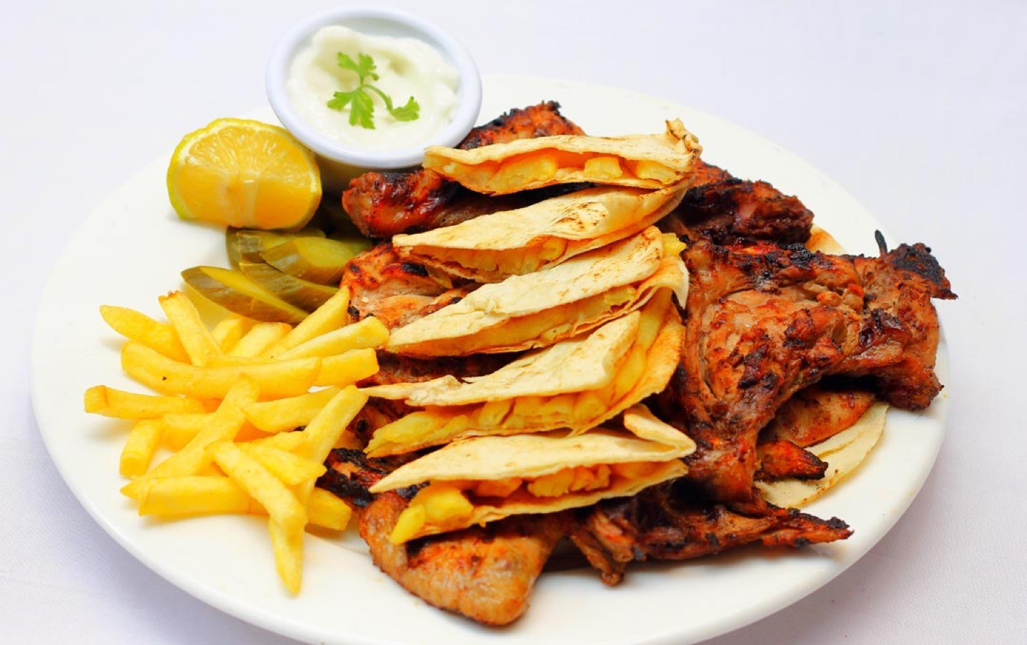 Charcoal grilled whole baby chicken